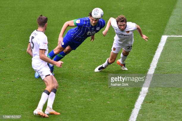 Kieffer Moore of Wigan Athletic scores his team's fourth goal during the Sky Bet Championship match between Wigan Athletic and Hull City at DW...