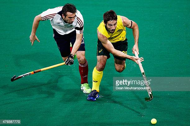 Kiel Brown of Australia battles for the ball with David Condon of Great Britain during the Fintro Hockey World League SemiFinal match between...