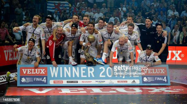 Kiel players celebrate after the EHF Final Four final match between THW Kiel and BM Atletico Madrid at Lanxess Arena on May 27 2012 in Cologne Germany