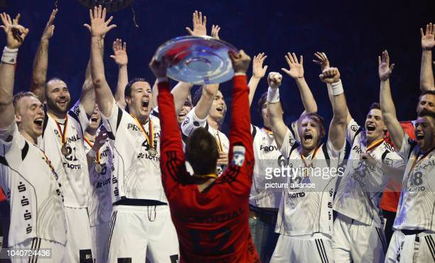 THW Kiel players celebrate the 20th German championship while goalkeer Andreas Palicka holds up the championship plate at the German Bundesliga...