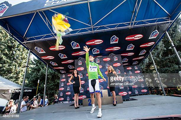 Kiel Reijnen of the UnitedHealthcare Pro Cycling Team throws his bouquet after winning the sprint jersey after his win on stage 3 of the USA Pro...