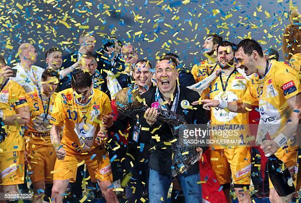 Kielce's headcoach Talant Dujshebaev celebrates with the trophy after winning the Handball EHF Champions League final Four Final match between KS...