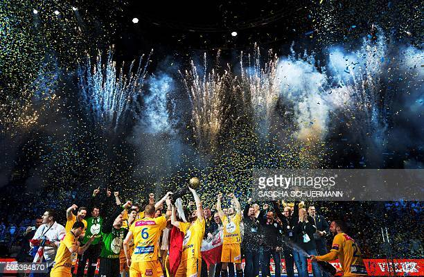 TOPSHOT Kielce's players celebrate with the trophy winning the Handball EHF Champions League final Four Final match between KS Vive Tauron Kielce and...