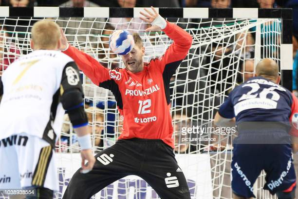 Kiel's Andreas Palicka vies for the ball with Copenhagen's Albert Rocas Comas  during the handball Champions League group B match between THW Kiel...