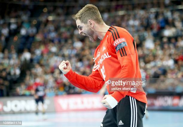 Kiel's goalkeeper Andreas Palicka reacts after stopping the handball Champions League group B match between THW Kiel ands KIF Kolding Copenhagen at...