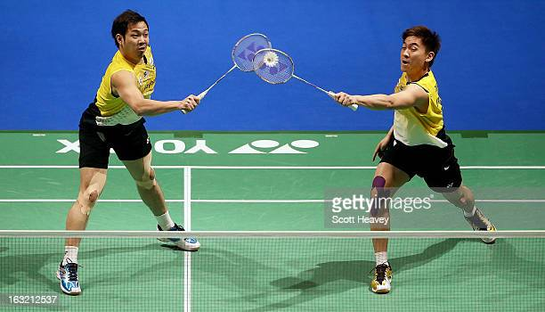 Kien Keat Koo and Boon Heong Tan of Malaysia in action during Day Two of the Yonex All England Badminton Open at NIA Arena on March 6, 2013 in...