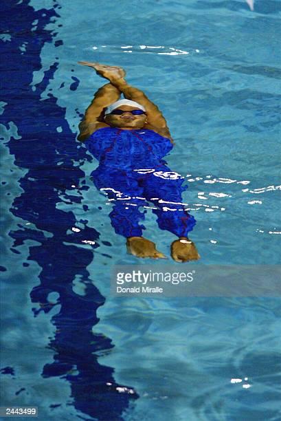 Kiera Aitken of Bermuda swims in the Women's 100M Backstroke during the Swimming Finals at the Juan Pablo Duarte Aquatics Center on August 13, 2003...
