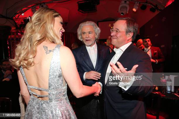 "Kiera Chaplin, Hermann Buehlbecker, CEO of Lambertz, and Armin Laschet, Prime Minister during the Lambertz Monday Night 2020 ""Wild Chocolate Party""..."