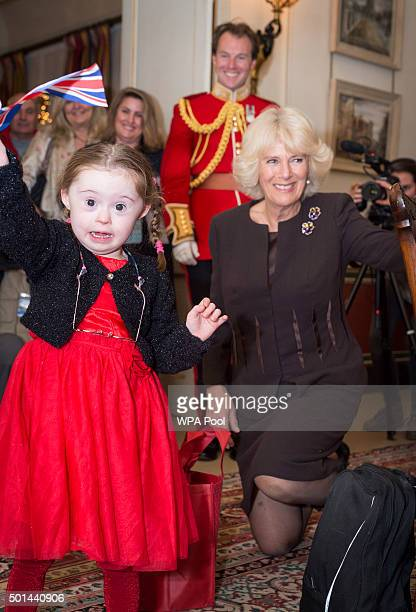 Kiera Holland 5 receives Christmas presents from the Duchess including a Union Jack Flag as Camilla Duchess of Cornwall patron of the Helen Douglas...
