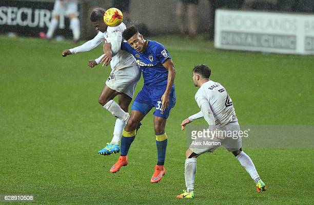 Kieran Agard of MK Dons and Lyle Taylor of AFC Wimbledon battle to win a header during the Sky Bet League One match between Milton Keynes Dons and...
