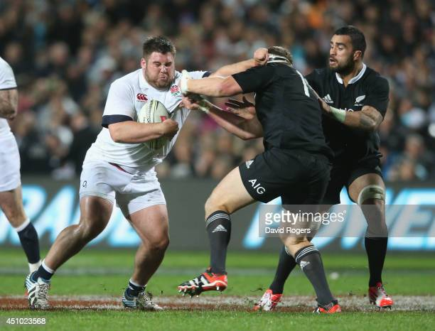 Kieran Brookes of England is tackeld during the International Test match between the New Zealand All Blacks and England at Waikato Stadium on June...