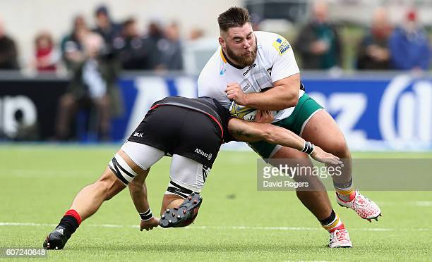 Kieran Brookes of Northampton is tackled by Michael Rhodes during the Aviva Premiership match between Saracens and Northampton Saints at Allianz Park...