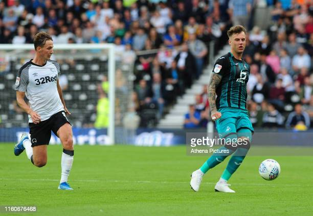 Kieran Dowell of Derby County battles with Joe Rodon of Swansea City during the Sky Bet Championship match between Derby County and Swansea City at...