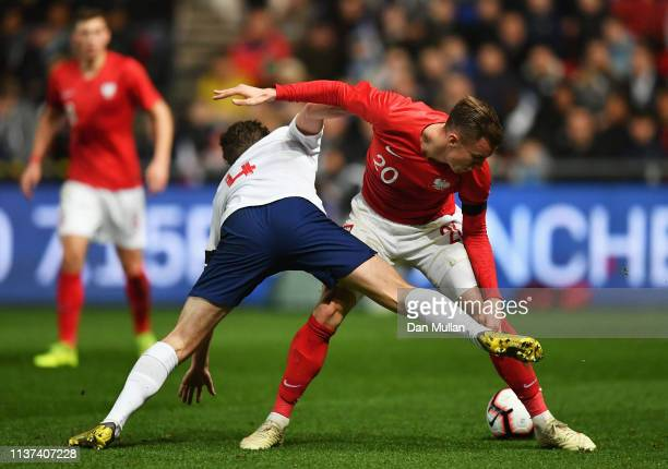 Kieran Dowell of England battles for the ball with Pawel Stolarski of Poland during the U21 International Friendly match between England and Poland...