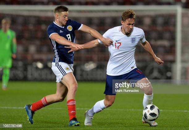 Kieran Dowell of England is challenged by Allan Campbell of Scotland during the 2019 UEFA European Under21 Championship Qualifier between Scotland...