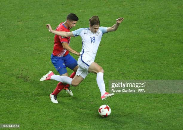 Kieran Dowell of England is challenged by Diego Mesen of Costa Rica during the FIFA U20 World Cup Korea Republic 2017 Round of 16 match between...