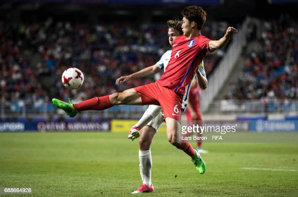 Kieran Dowell of England is challenged by Lee Seungmo of Korea Republic during the FIFA U20 World Cup Korea Republic 2017 group A match between...