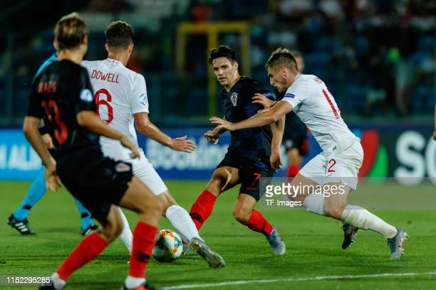 Kieran Dowell of England Josip Brekalo of Croatia and Jonjoe Kenny of England battle for the ball during the 2019 UEFA U21 Group C match between...