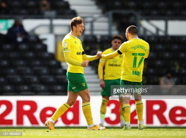 Kieran Dowell of Norwich City celebrates with Emi Buendia after scoring their team's first goal during the Sky Bet Championship match between Derby...