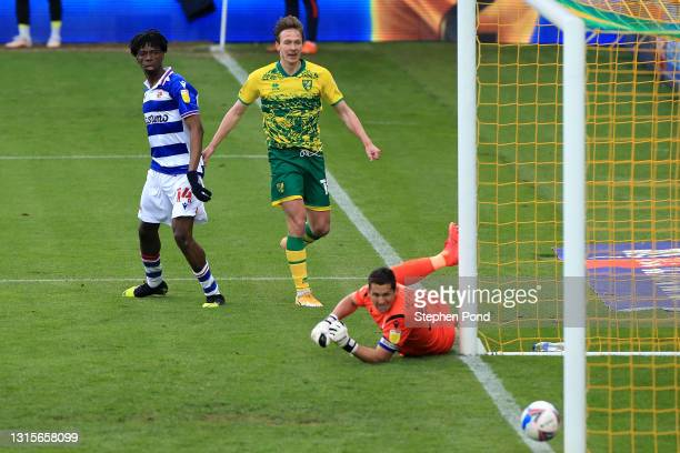 Kieran Dowell of Norwich City scores their team's second goal past Rafael of Reading FC during the Sky Bet Championship match between Norwich City...