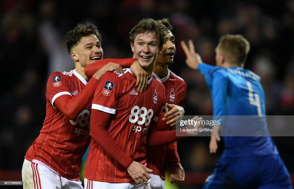 Kieran Dowell of Nottingham Forest celebrates scoring his team's fourth goal from the penalty spot as Per Mertesacker of Arsenal suggests he kicked the ball twice taking the penalty during The Emirates FA Cup Third Round match between Nottingham Forest and Arsenal at City Ground on January 7, 2018 in Nottingham, England.