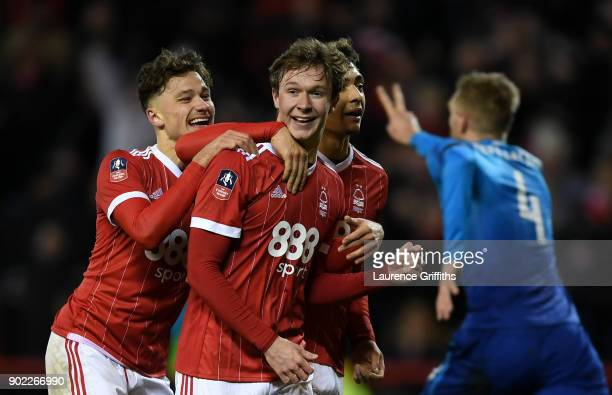 Kieran Dowell of Nottingham Forest celebrates scoring his team's fourth goal from the penalty spot as Per Mertesacker of Arsenal suggests he kicked...