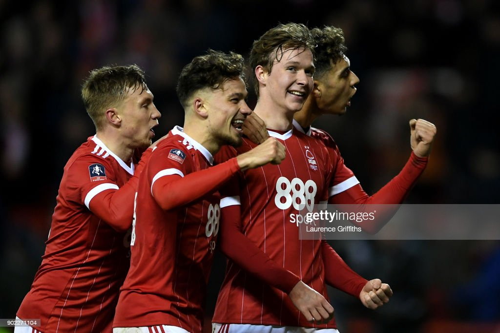 Kieran Dowell (C) of Nottingham Forest celebrates scoring his team's fourth goal from the penalty spot during The Emirates FA Cup Third Round match between Nottingham Forest and Arsenal at City Ground on January 7, 2018 in Nottingham, England.