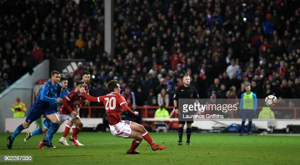 Kieran Dowell of Nottingham Forest scores his team's fourth goal from the penalty spot during The Emirates FA Cup Third Round match between...
