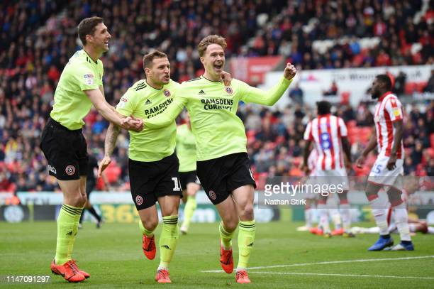 Kieran Dowell of Sheffield United celebrates as he scores his team's first goal with Billy Sharp and Chris Basham during the Sky Bet Championship...