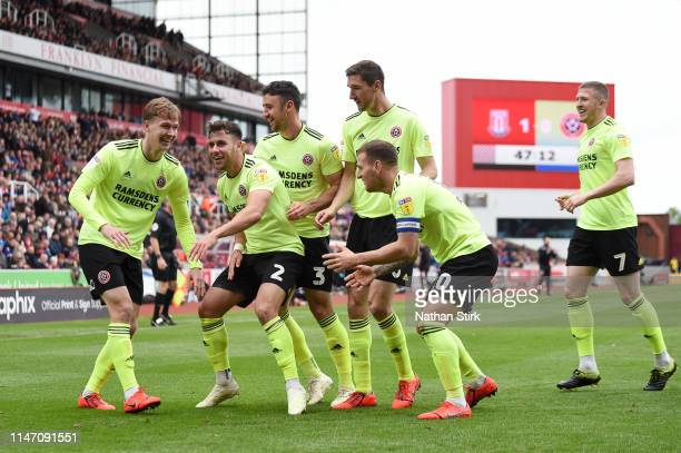 Kieran Dowell of Sheffield United celebrates as he scores his team's first goal with team mates during the Sky Bet Championship match between Stoke...