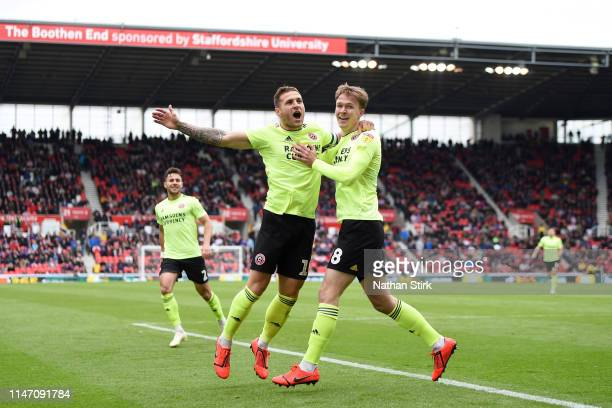 Kieran Dowell of Sheffield United celebrates as he scores his team's first goal with Billy Sharp during the Sky Bet Championship match between Stoke...