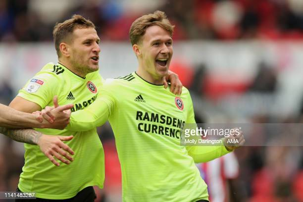 Kieran Dowell of Sheffield United celebrates with Billy Sharp of Sheffield United after scoring a goal to make it 10 during the Sky Bet Championship...