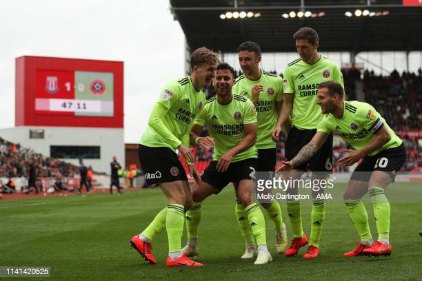 Kieran Dowell of Sheffield United celebrates with team mates after scoring a goal to make it 11 during the Sky Bet Championship match between Stoke...