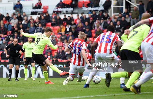 Kieran Dowell of Sheffield United scores his team's first goal during the Sky Bet Championship match between Stoke City and Sheffield United at...