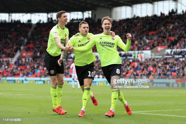 Kieran Dowell of Sheff Utd celebrates with Chris Basham of Sheff Utd and Billy Sharp of Sheff Utd after scoring their 1st goal during the Sky Bet...