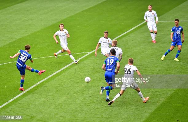 Kieran Dowell of Wigan Athletic scores his team's third goal during the Sky Bet Championship match between Wigan Athletic and Hull City at DW Stadium...