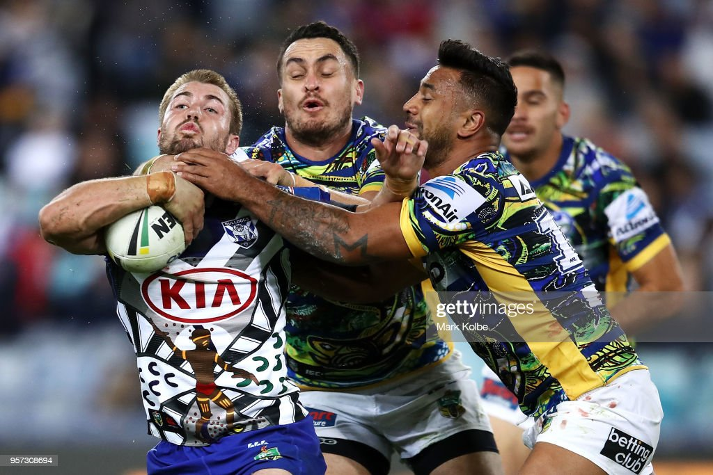 Kieran Foran of the Bulldogs is tackled by Tepai Moeroa and Kenny Edwards of the Eels during the round 10 NRL match between the Canterbury Bulldogs and the Parramatta Eels at ANZ Stadium on May 11, 2018 in Sydney, Australia.