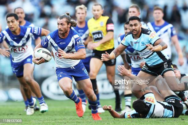 Kieran Foran of the Bulldogs makes a break during the round 15 NRL match between the Canterbury Bulldogs and the Cronulla Sharks at ANZ Stadium on...