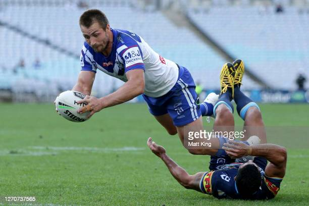 Kieran Foran of the Bulldogs scores a try during the round 17 NRL match between the Canterbury Bulldogs and the Gold Coast Titans at ANZ Stadium on...