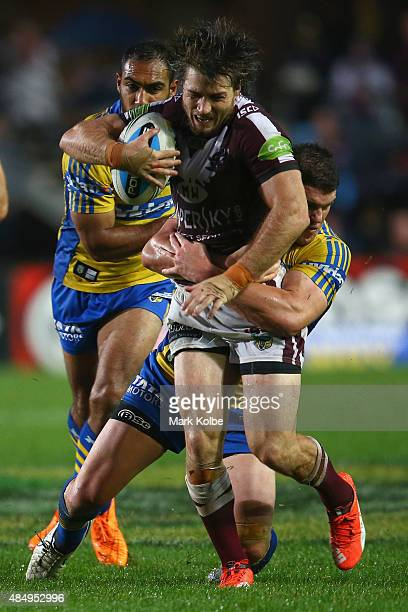 Kieran Foran of the Eagles is tackled during the round 24 NRL match between the Manly Warringah Sea Eagles and the Parramatta Eels at Brookvale Oval...