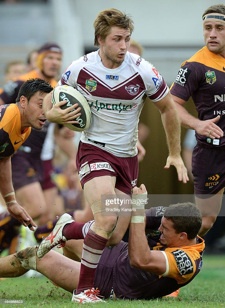 Kieran Foran of the Sea Eagles attempts to break away from the defence during the round 12 NRL match between the Brisbane Broncos and the Manly-Warringah Sea Eagles at Suncorp Stadium on June 1, 2014 in Brisbane, Australia.