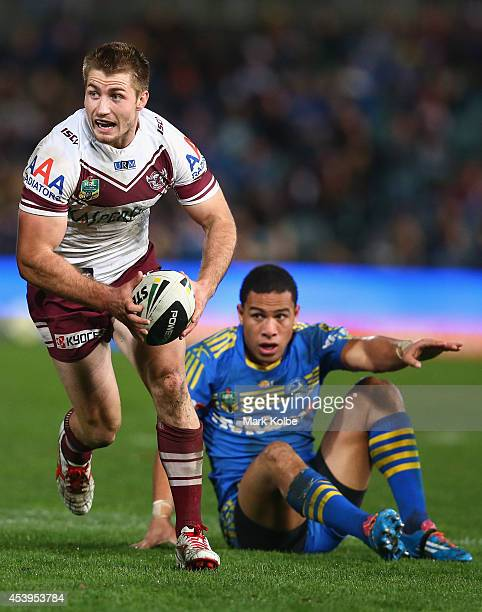 Kieran Foran of the Sea Eagles beats the tackle of Will Hopoate of the Eels during the round 24 NRL match between the Parramatta Eels and the Manly...