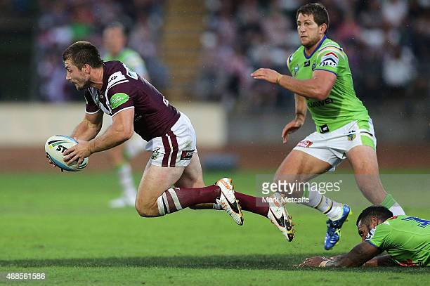 Kieran Foran of the Sea Eagles is tackled by Sisa Waqa of the Raiders during the round five NRL match between the Manly Sea Eagles and the Canberra...