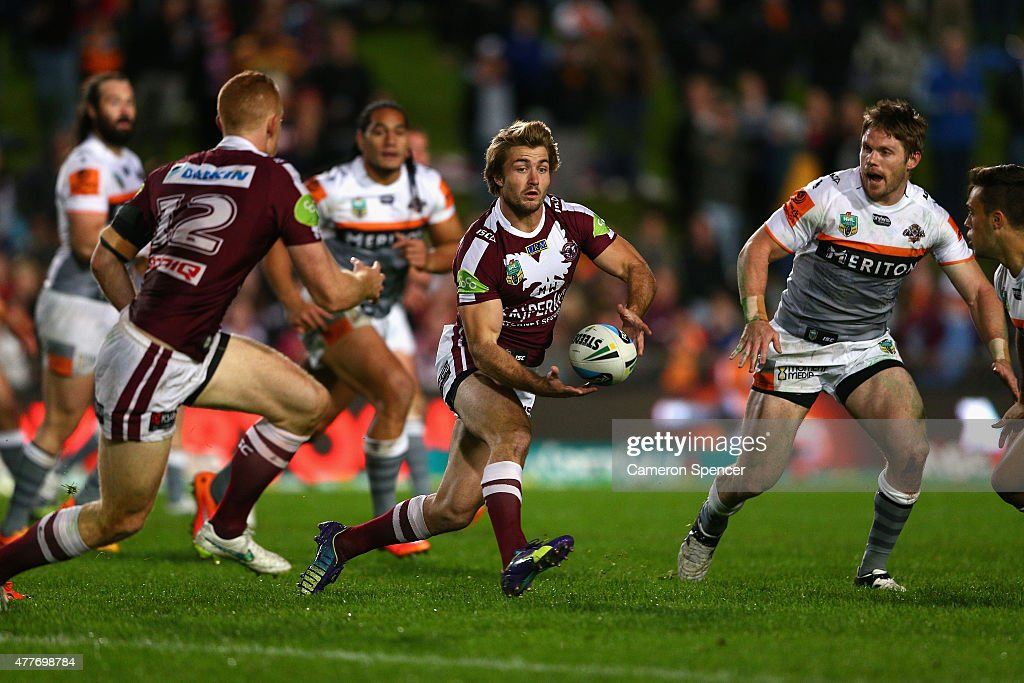 Kieran Foran of the Sea Eagles passes during the round 15 NRL match between the Manly Sea Eagles and the Wests Tigers at Brookvale Oval on June 19, 2015 in Sydney, Australia.