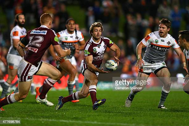 Kieran Foran of the Sea Eagles passes during the round 15 NRL match between the Manly Sea Eagles and the Wests Tigers at Brookvale Oval on June 19...