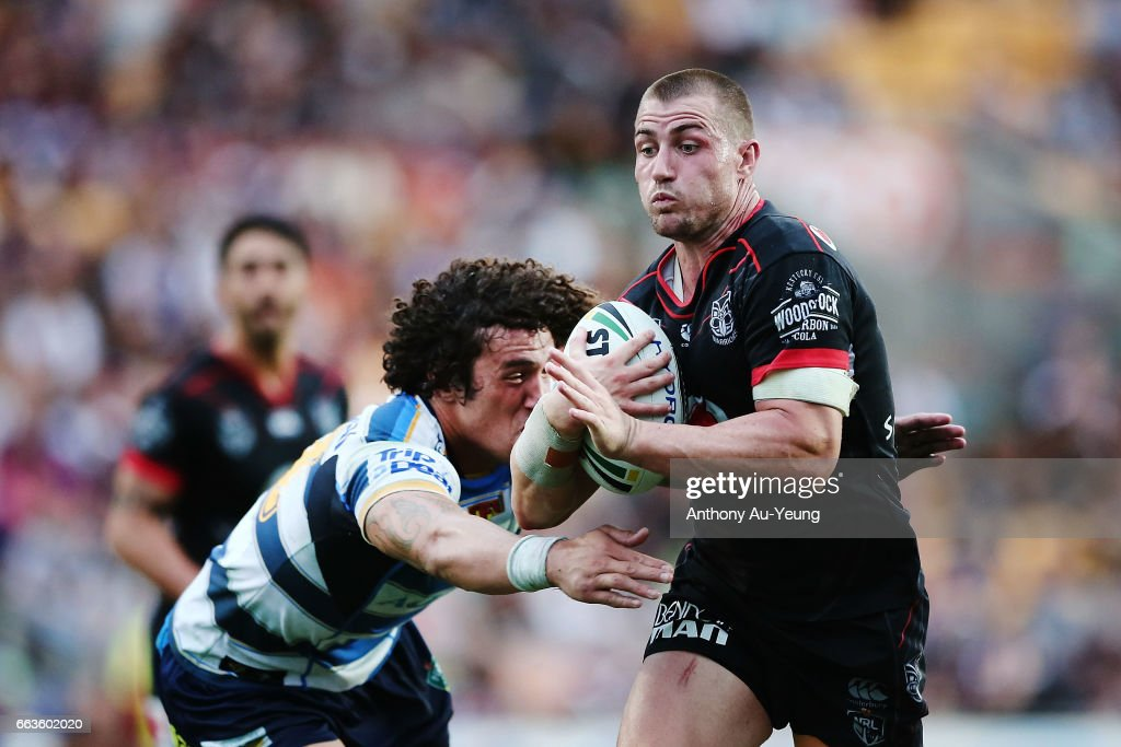 Kieran Foran of the Warriors beats the tackle from Kevin Proctor of the Titans to runs in a try during the round five NRL match between the New Zealand Warriors and the Gold Coast Titans at Mt Smart Stadium on April 2, 2017 in Auckland, New Zealand.