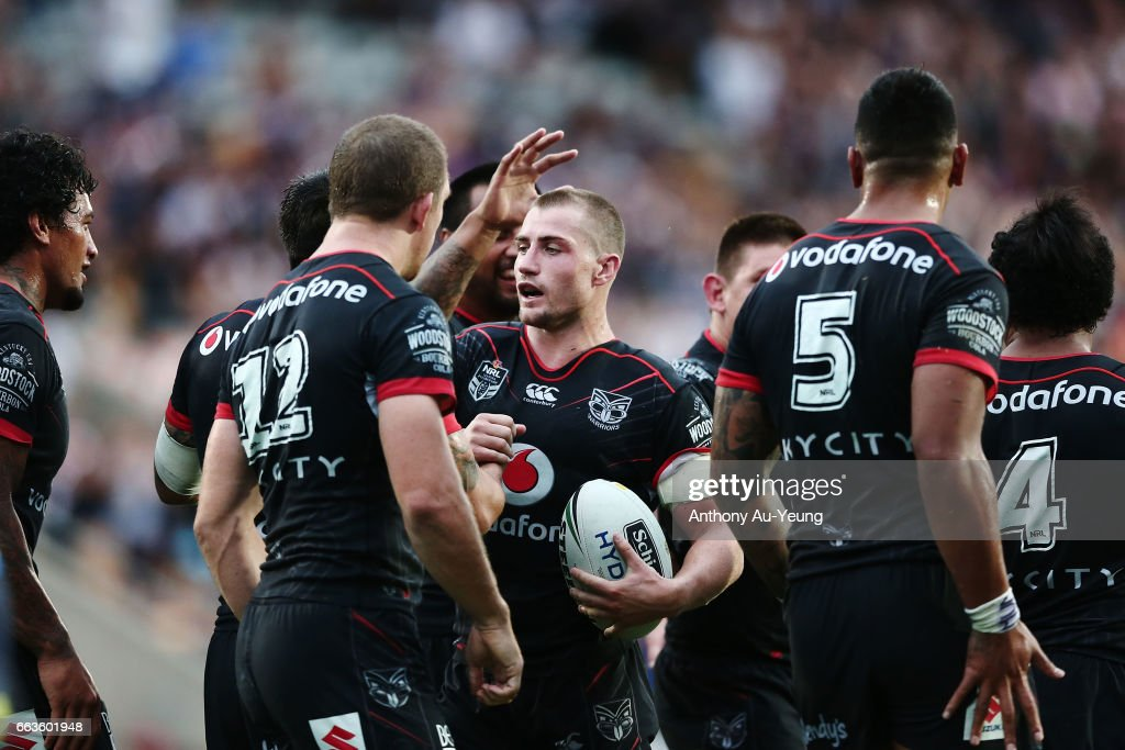 Kieran Foran of the Warriors celebrates with teammates after scoring a try during the round five NRL match between the New Zealand Warriors and the Gold Coast Titans at Mt Smart Stadium on April 2, 2017 in Auckland, New Zealand.