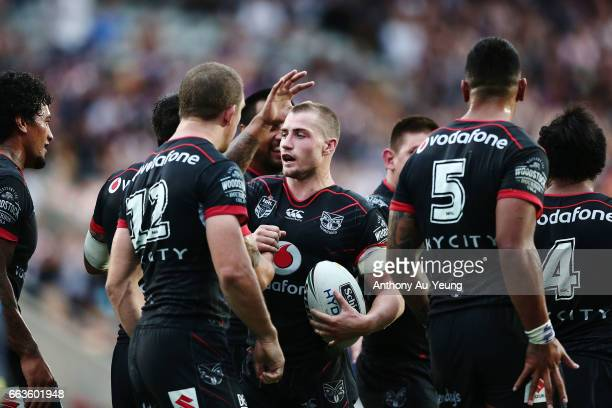 Kieran Foran of the Warriors celebrates with teammates after scoring a try during the round five NRL match between the New Zealand Warriors and the...