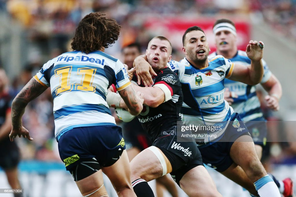 Kieran Foran of the Warriors is tackled by Ryan James of the Titans during the round five NRL match between the New Zealand Warriors and the Gold Coast Titans at Mt Smart Stadium on April 2, 2017 in Auckland, New Zealand.