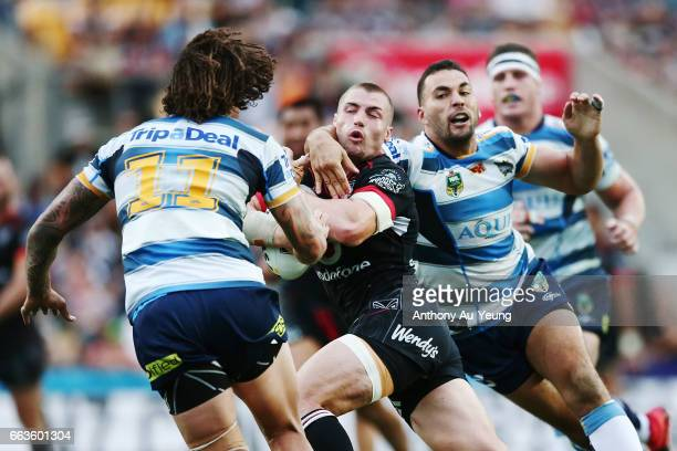 Kieran Foran of the Warriors is tackled by Ryan James of the Titans during the round five NRL match between the New Zealand Warriors and the Gold...